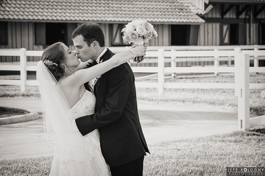 Wedding Couple shares a kiss on their wedding day.