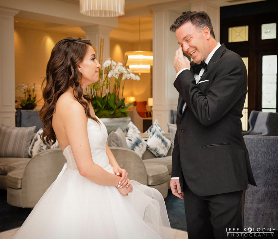 The Brides father wiping his eyes after a very emotional First Look with his daughter.