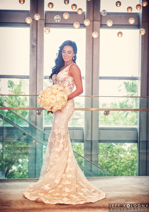 The bride looks awesome at her Eden Roc Miami Beach wedding.