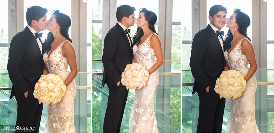 Bride and Groom kissing at the Eden Roc Hotel.