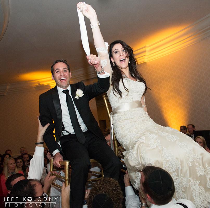 This Jewish wedding horah shot was taken at The Eden Roc Hotel.