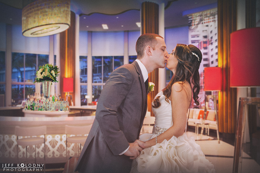 Bride and groom kissing at their Eden Roc Hotel wedding.