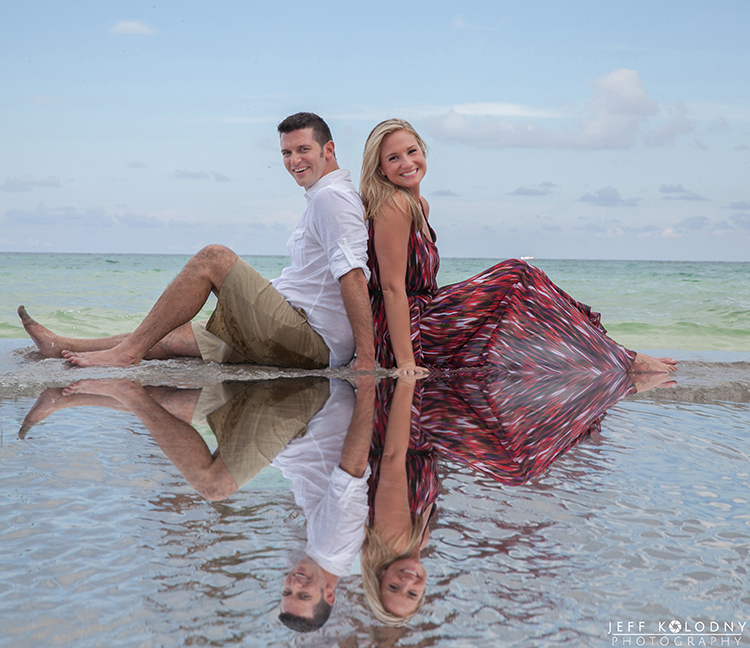 Puddles left over from a recent rain storm made the foreground for this South Florida Beach Engagement photo.