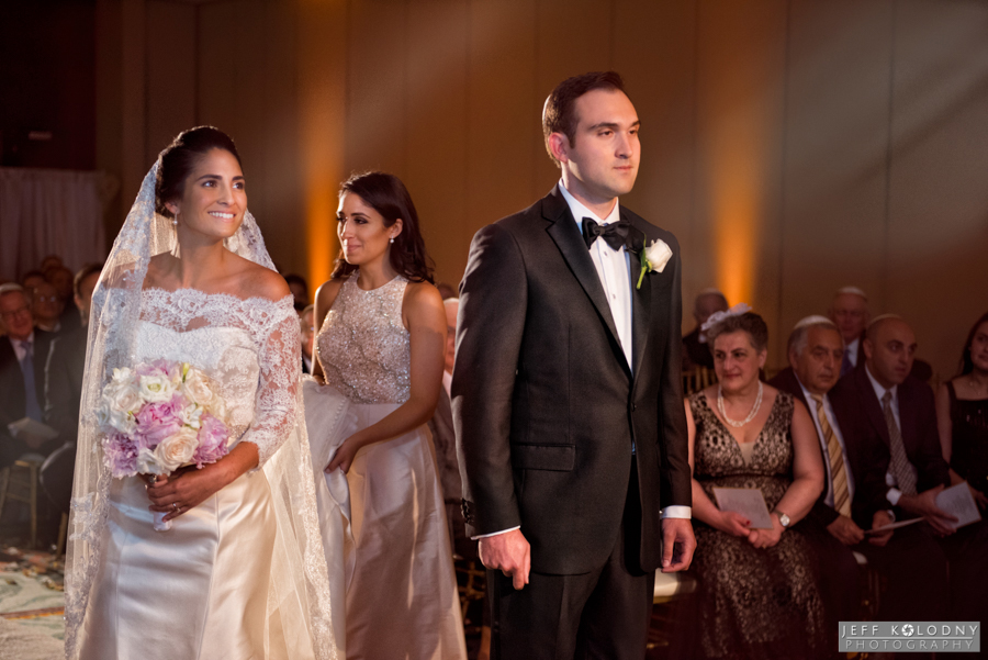 This wedding photo was taken in the hotels Ocean Ballroom. I shot this at the beginning of a Jewish wedding. Before a Jewish bride and groom proceed under the huppah to get married the bride circles the groom 7 times.
