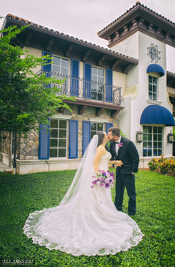 Bride and Groom share a kiss at The Club at Boca Pointe.