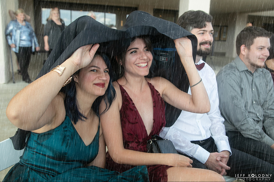 Wedding guests covering their heads as the rain fell.