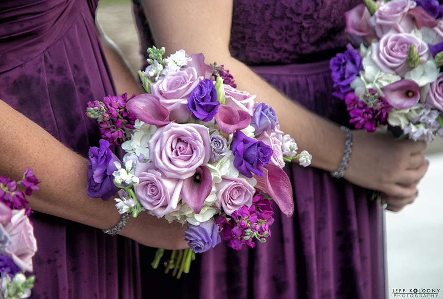 Colorful bridesmaids flowers that match the bridesmaids dresses.