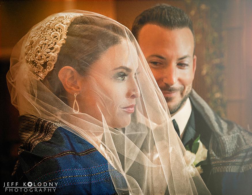 Bride and groom at a Jewish wedding ceremony