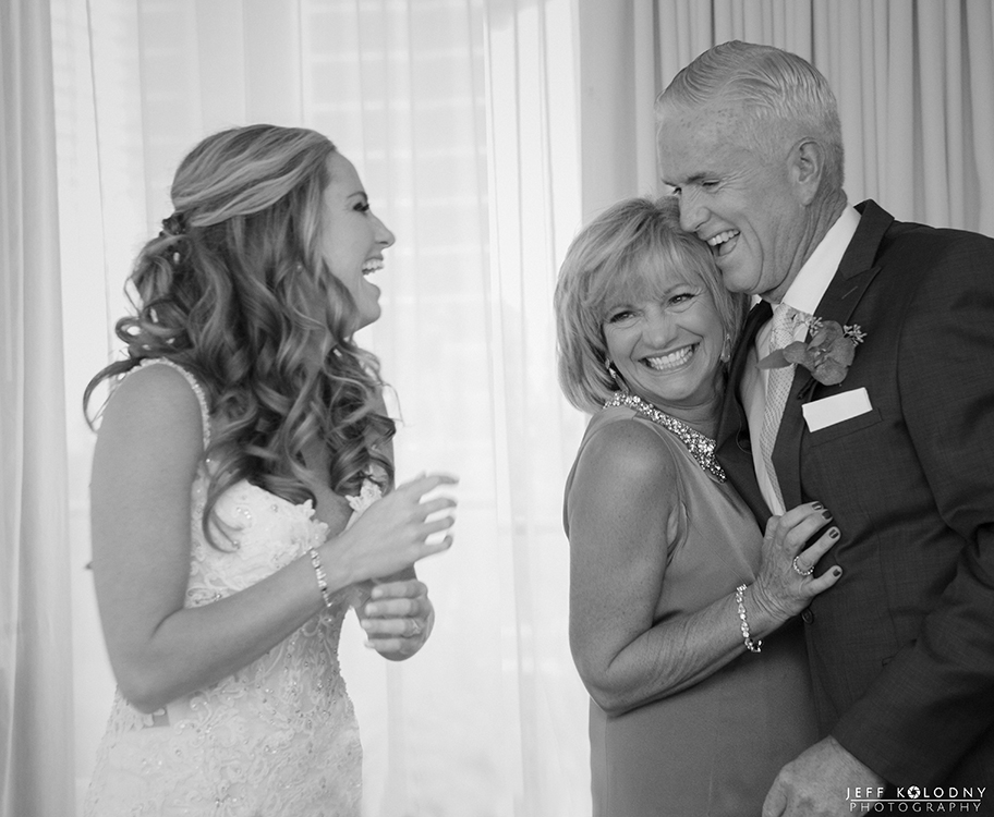 Picture of the bride enjoying the company of her parents.