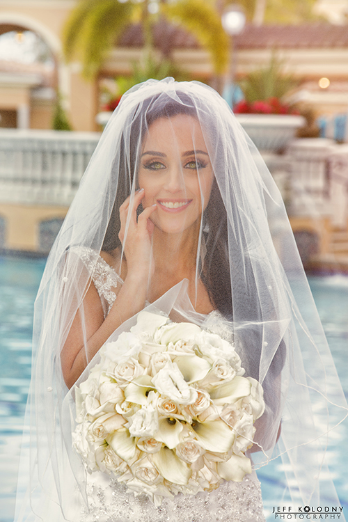 Bride with amazing eyes photographed at The County Club at Mirasol.