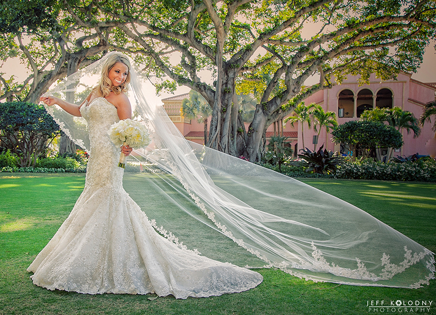 Boca Resort wedding picture of a bride with her veil blowing in the wind