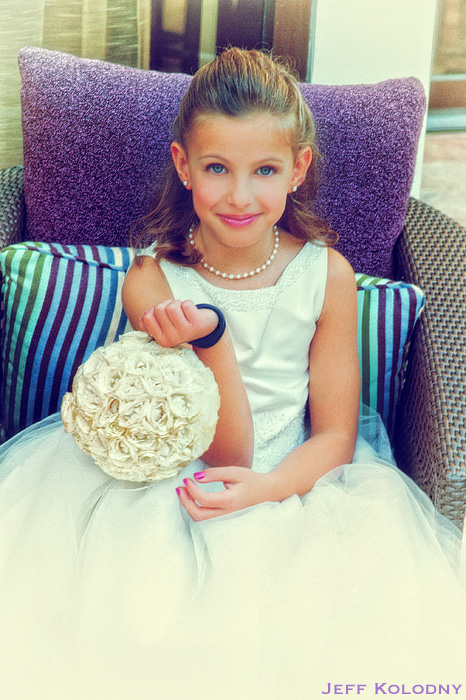 Creative flower girl photo taken at a wedding in Miami.