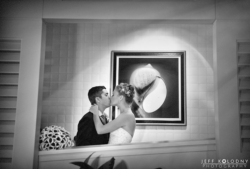 Bride and groom kiss at the Ritz - Carlton Fort Lauderdale.