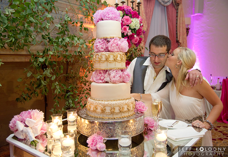 Bride and Groom cutting their wedding cake at The Breakers in Palm Beach.