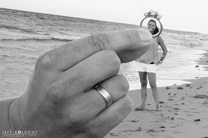 A fun and creative engagement photo taken on a South Florida Beach.