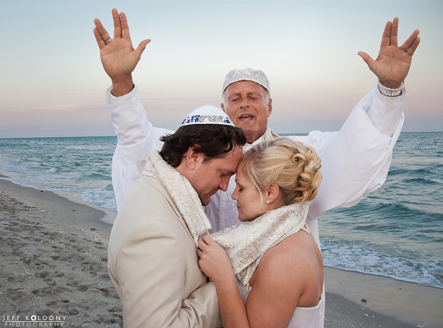 This couple hired a Rabbi to perform their Jewish elopement ceremony on a Boca Raton beach.