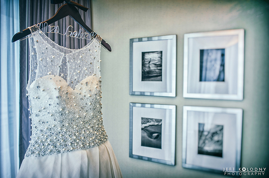 Wedding gown hanging on its special custom hanger.