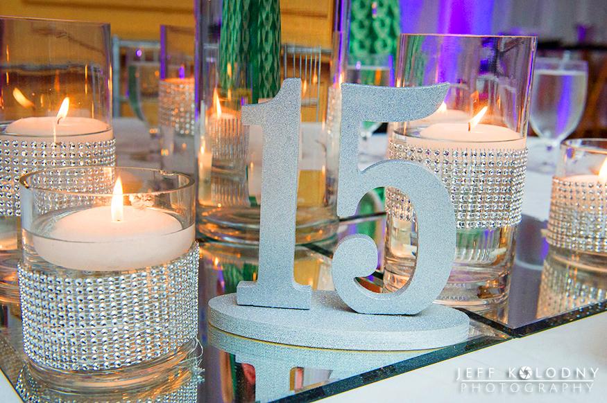 Custom made numbers on each ballroom table.