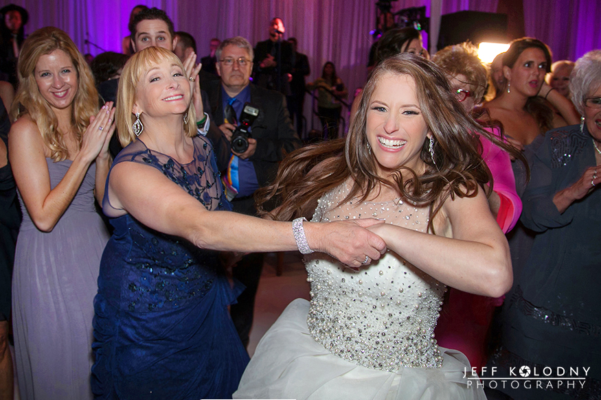 Bride and her mother having good time at the wedding reception
