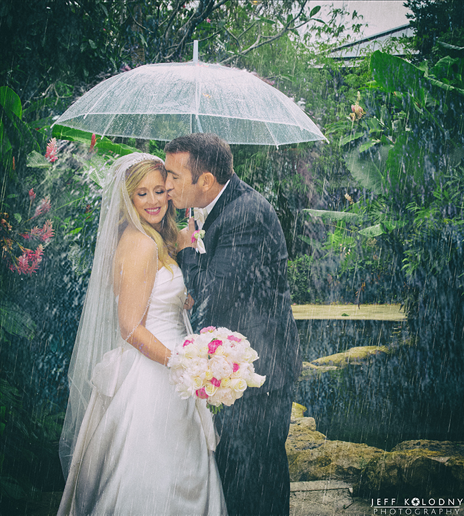Wedding photo taken in the Rain at the Sundy House.