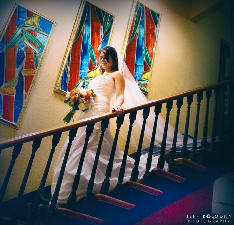 Bride walking down the stairs to start her Sundy House wedding ceremony.
