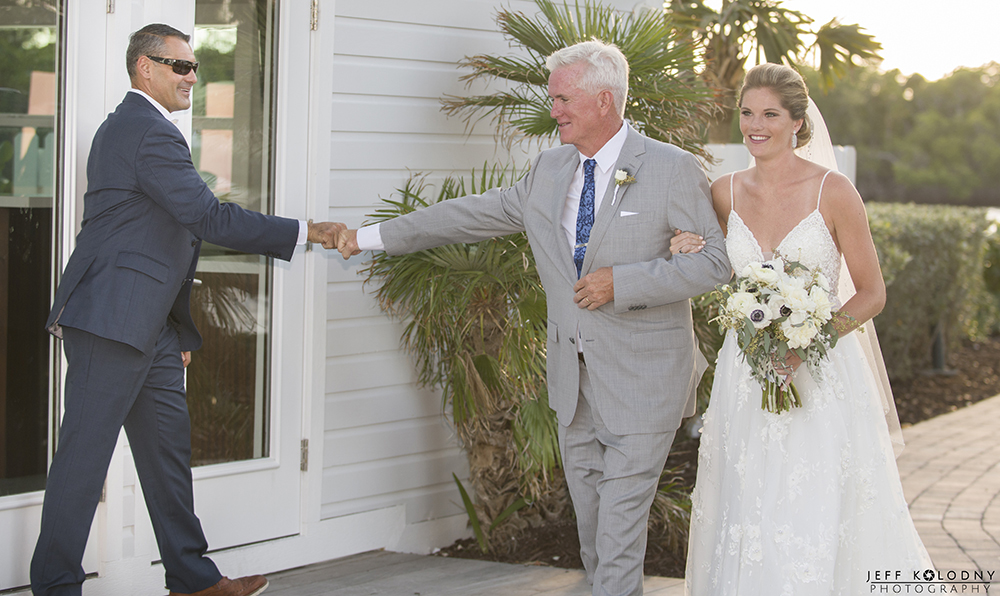 During the walk down the aisle, the brides father and the director of catering, Christian Sarquis fist bump.