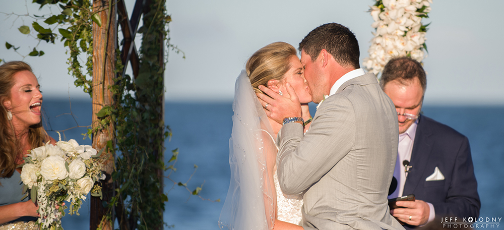 Bride and Groom's first kiss as a married couple at their Ocean Reef Club wedding.