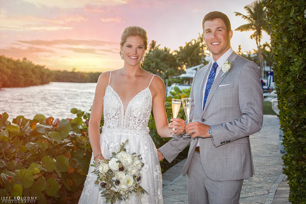 Ocean Reef Club wedding picture taken with the light from a beautiful setting sun.