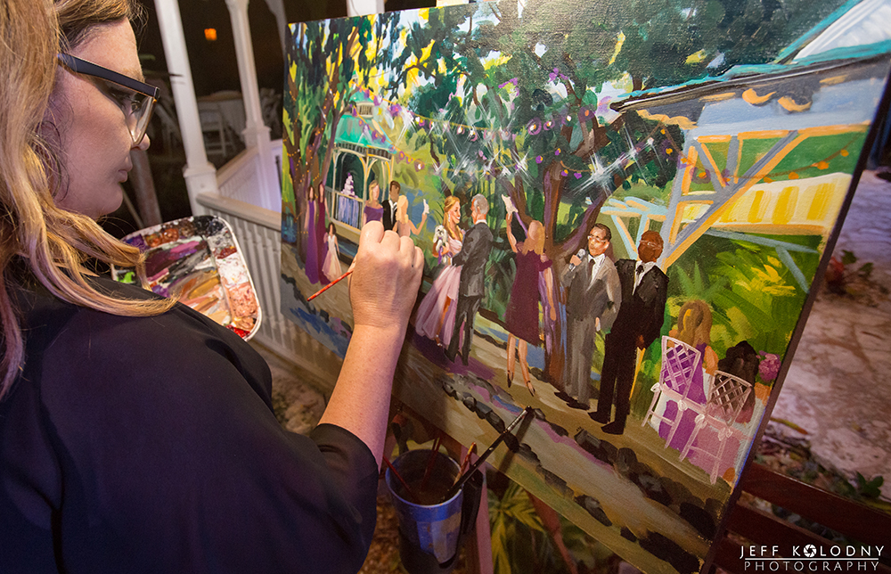 Artist painting at a real wedding.
