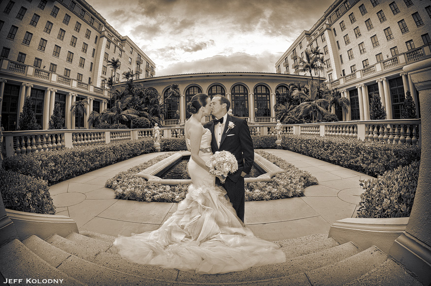 Romantic wedding picture taken in the Breakers Palm Beach courtyard.