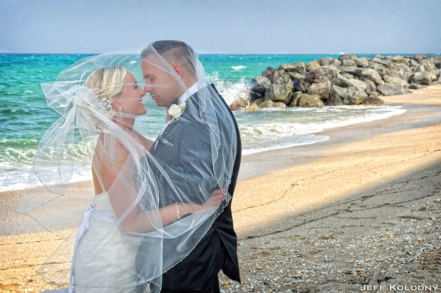 Bride and Groom on the beach at The Breakers in Palm Beach Florida.