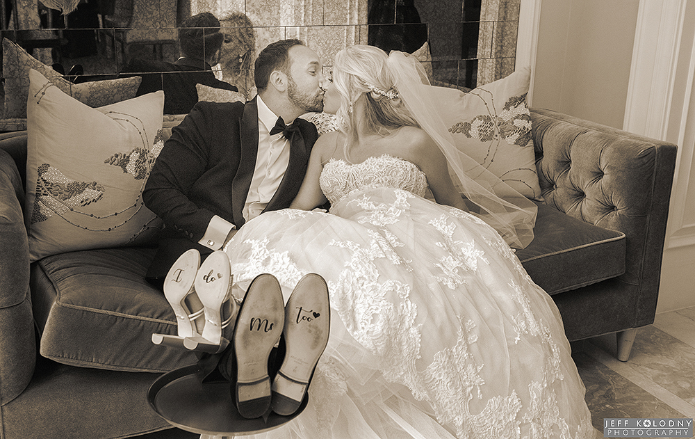 """Bride and Groom showing off their """"I do's"""" at their Palm Beach wedding."""