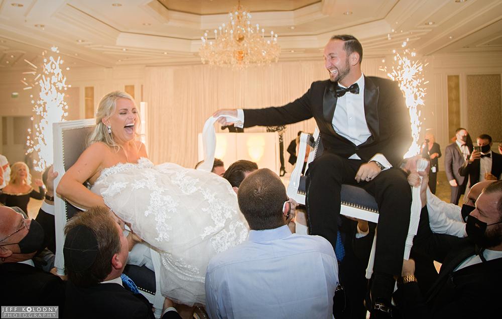 wedding reception action shot taken in the Eau Palm Beach ballroom
