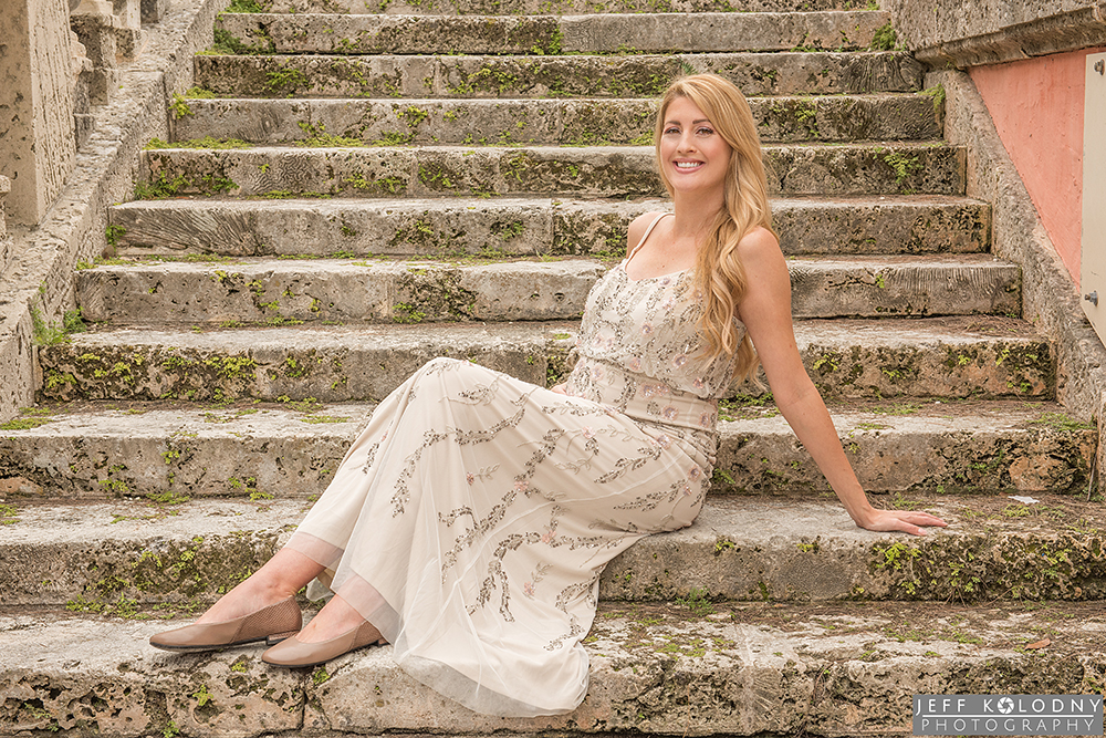 a very pregnant Jessica posing on the vintage looking Vizcaya stairs.