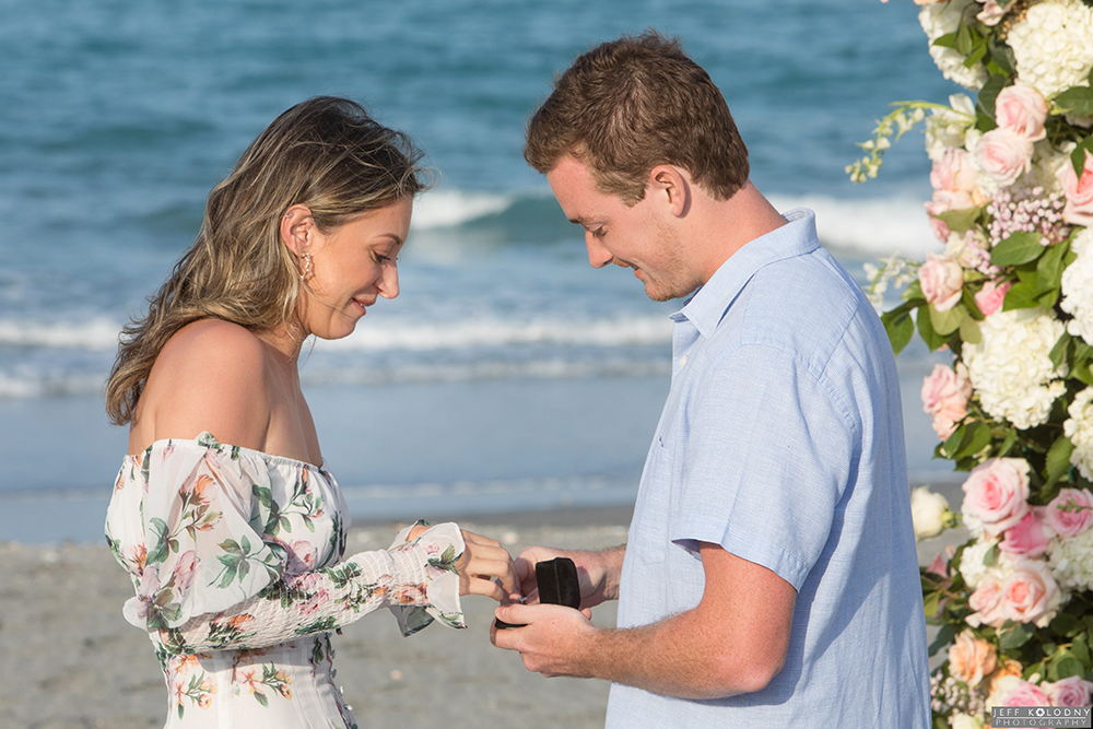 A soon to be fiancé tries on her new engagement ring for the first time at the romantic Florida beach location