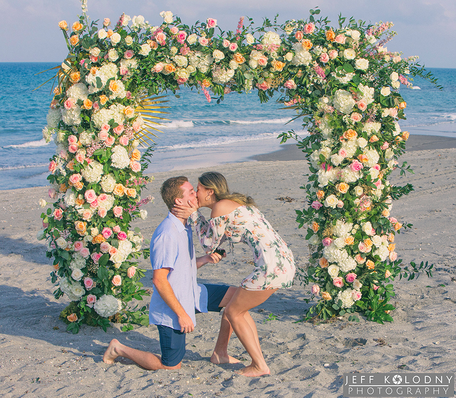 Kissing on a South Florida beach after a marriage proposal