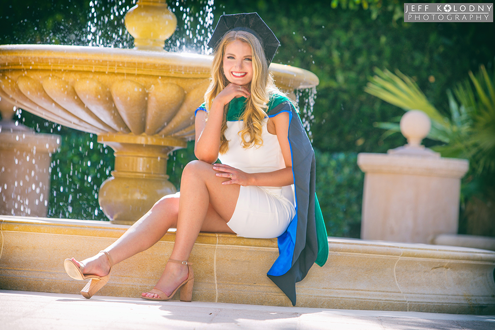 Senior portrait taken in front of a fountain in Palm Beach, Florida