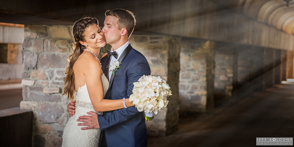 Bride and groom photographed inside a tunnel at Parkland Country Club