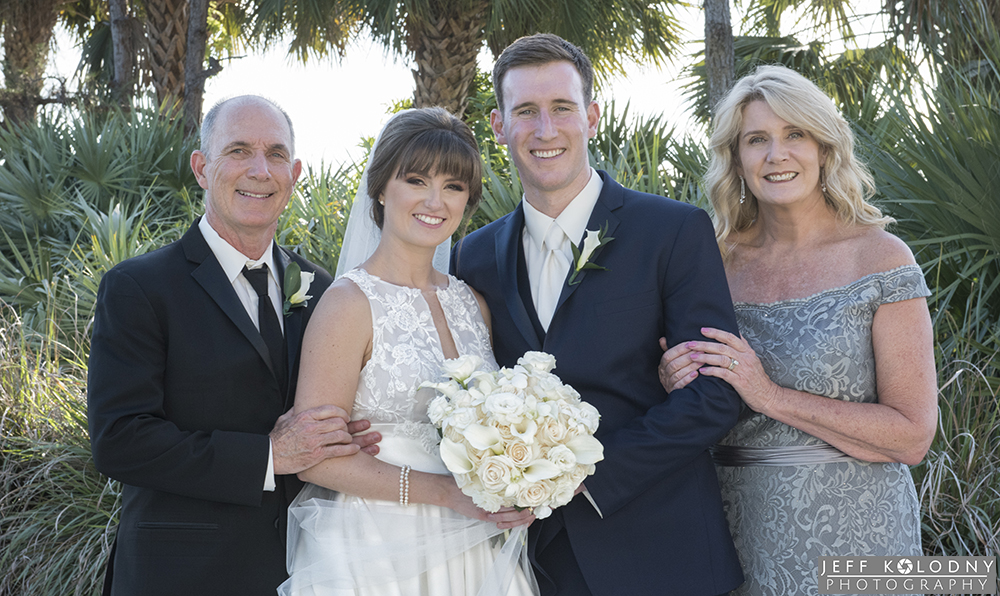 Bride and groom with the grooms parents.