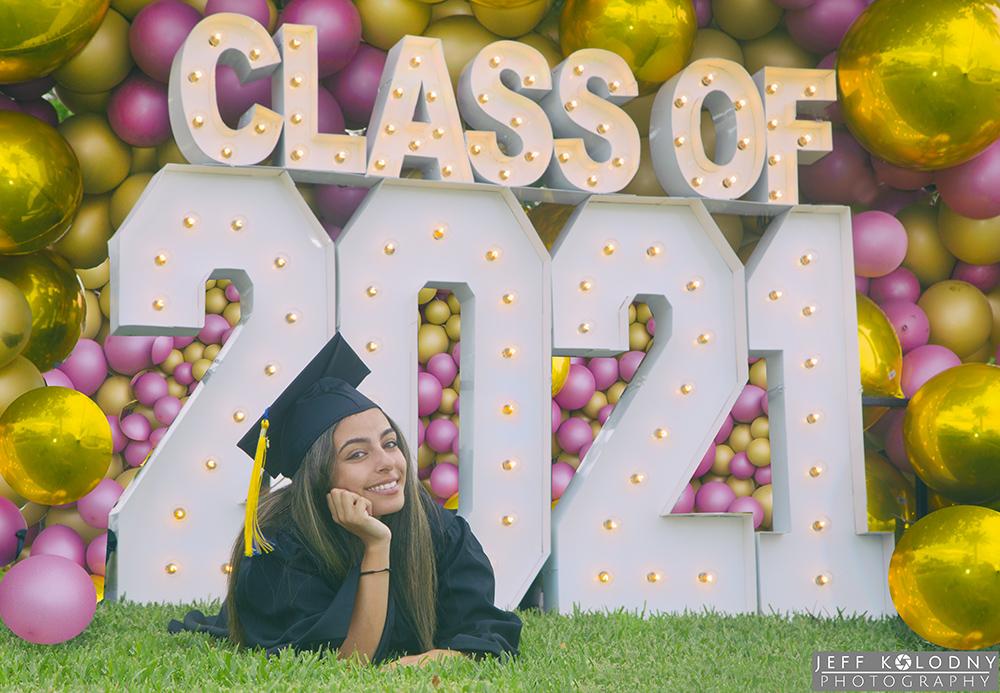 Graduating senior posing for her picture