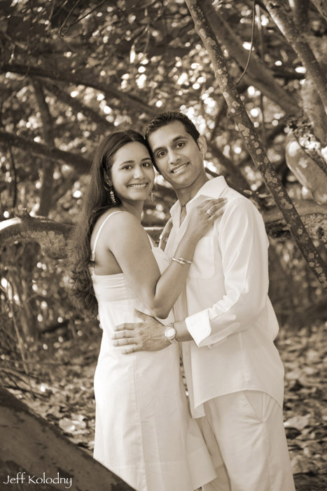 Indian couple smiling at the camera during their engagement photo session.